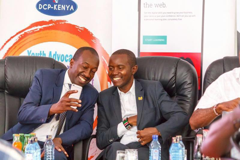 The Kisumu County Minister for Information, Communication and Technology (ICT) Hon. Michael Onyango on the left with the Cabinet Secretary for ICT, Hon. Joe Mucheru who was the chief guest during the Barefoot Youth Squad Digital Training that over 3,000 youths attending in Tom Mboya Labour College in Kisumu.